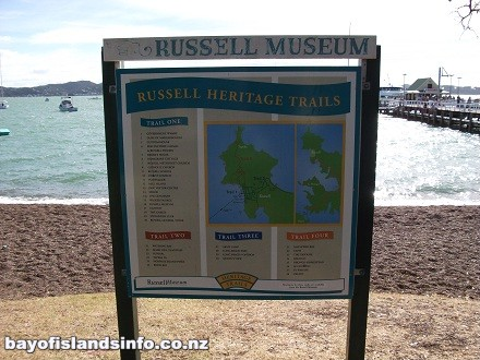 Russell Heritage Trail sign located on the waterfront Strand, Russell