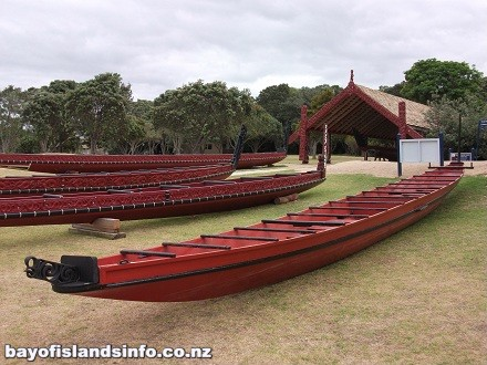 Maori War waka or canoes. Carvings and traditional red painting